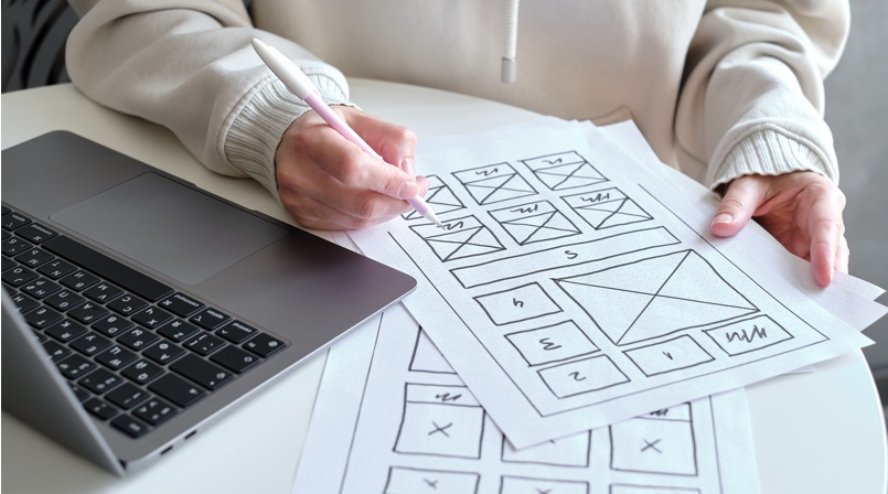 Woman drawing lo-fi wireframes - All you need to know about UX Design